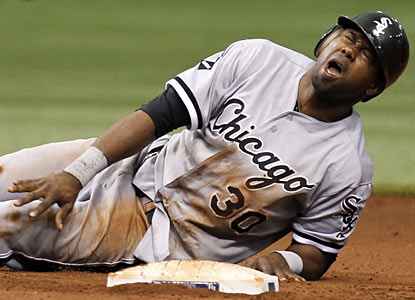 Alejandro De Aza leaves in the sixth inning after getting hit by a ball near the knee on a pick-off attempt. (AP)
