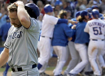 The Padres' Dale Thayer walks off the field dejected after he serves up a game-winning home run to the Cubs. (AP)