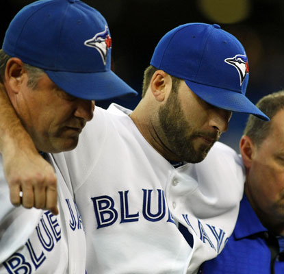 Brandon Morrow suffers a bruised right shin and is helped off the field in the seventh inning.  (US Presswire)