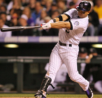 Carlos Gonzalez hits a two-run drive in the sixth, the second of his three home runs against the Astros.  (US Presswire)