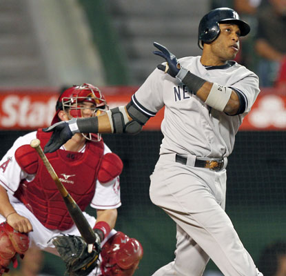 Robinson Cano hits a two-run shot to help the Yankees avoid a sweep to the Angels.  (AP)