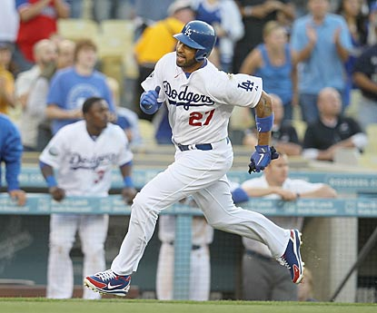Matt Kemp hustles to score from first base in the first inning, but aggravates his tender hamstring in the process.  (Getty Images)