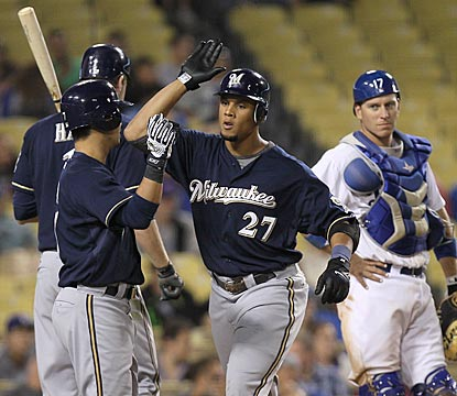 Dodgers catcher A.J. Ellis looks on in the ninth inning as the Brewers celebrate Carlos Gomez's (27) home run.  (Getty Images)