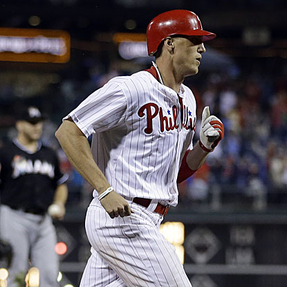 Hunter Pence goes 3 for 4 with a two-run home run as the Phillies hold on to defeat the Marlins.  (AP)