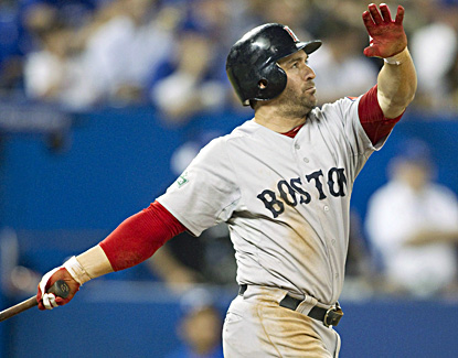 Nick Punto watches his home run off Blue Jays pitcher Carlos Villanueva during the ninth inning of Boston's win. (AP)