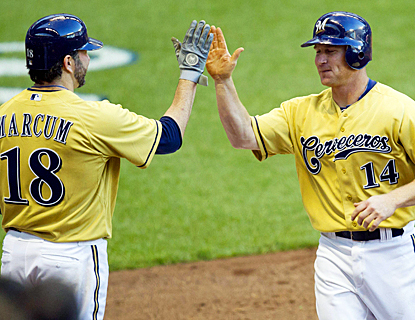 Brooks Conrad, who ends his 0-for-27 slump, celebrates his homer with Shawn Marcum. (US Presswire)