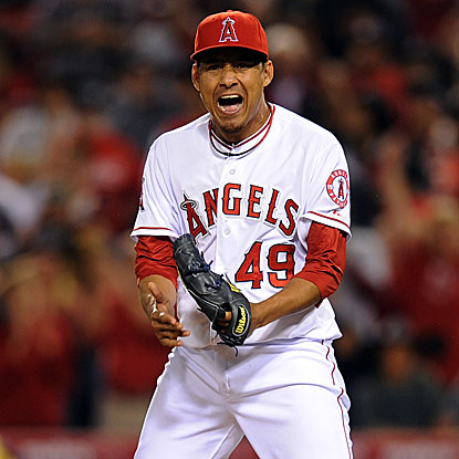 The Angels closer Ernesto Friere strikes out the Rangers' Josh Hamilton in the ninth inning to earn the save.  (US Presswire)