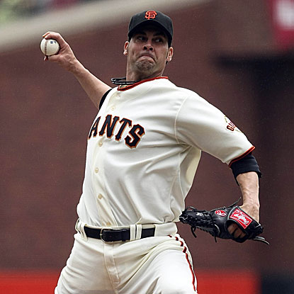 The Giants' Ryan Vogelsong allows two earned runs in seven innings to beat the Cubs and win his fourth straight decision.  (US Presswire)