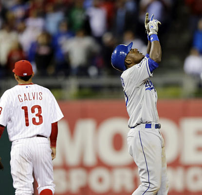 The Dodgers' Elian Herrera hurts Cliff Lee's bid for his first win by hitting a two-run double in the eighth. (AP)
