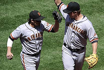 Ryan Theriot accounts for four hits to back  Matt Cain's nine strikeout game as the Giants win despite four errors. (Getty Images)