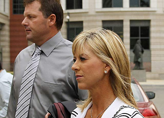 Debbie Clemens' (pictured with Roger Clemens) testimony contradicts Brian McNamee's. (AP)