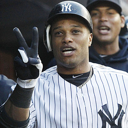 The Yanks' Robinson Cano hits two HRs, with the second beginning a string of three straight off Mets starter Johan Santana.  (US Presswire)