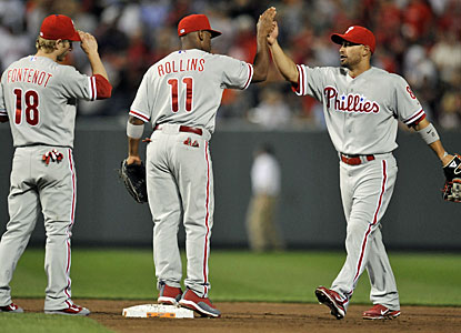 Shane Victorino (right) has good reason to be happy after helping his team with a homer and five runs. (US Presswire)