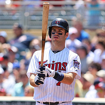 Joe Mauer returns to the Twins' lineup after a four-game absence and collects three hits and two RBI.  (Getty Images)
