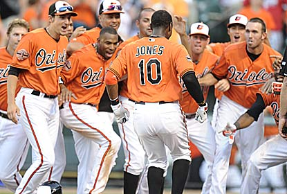 Adam Jones, who enters in an 0-for-18 slump, hits the game winner to give the O's their eighth straight extra-inning win. (Getty Images)