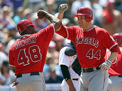 Torii Hunter and Mark Trumbo combine to go 5 for 9 with three home runs, eight RBI and five runs scored.  (AP)