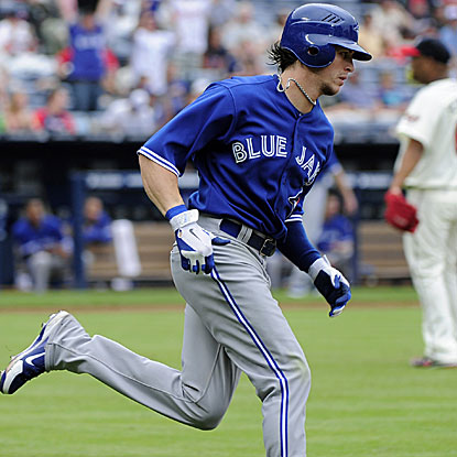 Colby Rasmus homers and collects three RBI to help the Blue Jays snap the Braves' six-game winning streak.  (AP)