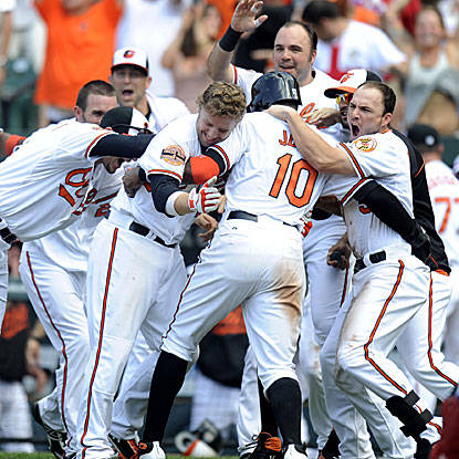 Adam Jones is welcomed home after scoring from first base on Matt Wieters' hit to help create team history for the Orioles. (Getty Images)