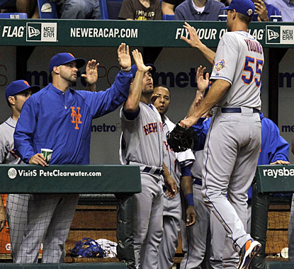 Chris Young is cheered by his teammates after throwing 106 pitches to earn his first win since April 5, 2011. (AP)