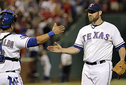 Colby Lewis strikes out seven and retires the first 16 batters to finish with a four-hitter for his fifth win. (AP)
