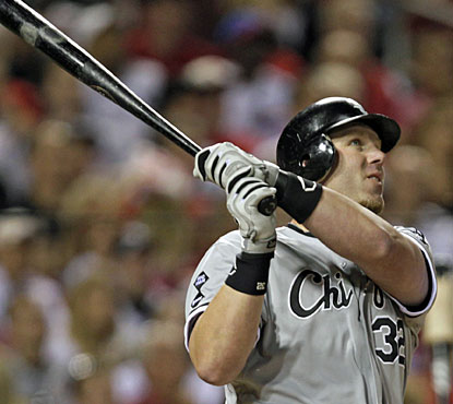 Adam Dunn takes a long look at what is his 21st home run of the season for the White Sox. (AP)