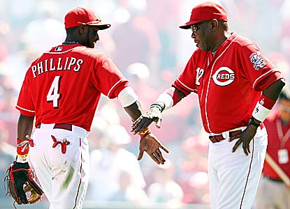 Brandon Phillips, getting praise from Dusty Baker, homers and drives in four a day after taking a Derek Lowe pitch on his arm. (Getty Images)