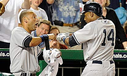 Derek Jeter and Curtis Granderson do most of the damage in the matchup of first-place teams, combining for four RBI. (Getty Images)