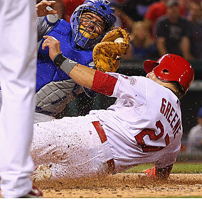 The Cardinals' Tyler Greene is thrown out at home plate to end the game, lifting the Royals to victory.  (Getty Images)
