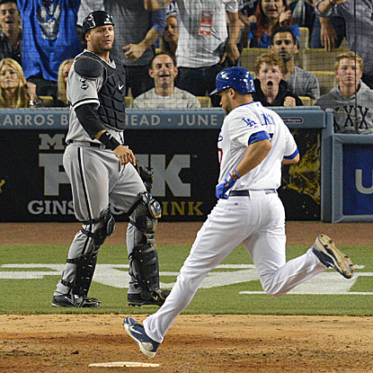 James Loney scores what turns out to be the Dodgers' winning run on a wild pitch in the eighth inning.  (AP)