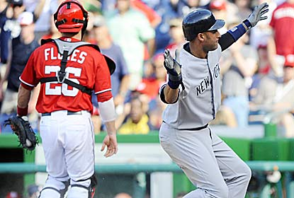 Derek Jeter scores on Mark Teixeira's 14th-inning double, which sends the Yanks to their eighth straight victory. (US Presswire)