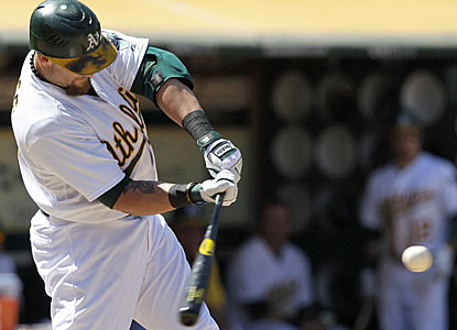 Jonny Gomes comes off the bench to help the Athletics with a two-run pinch-hit homer. (AP)