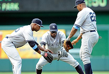 The New York outfield comes together in celebration of the Yanks' victory over the Nationals -- their ninth straight.  (Getty Images)