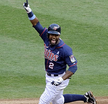 Denard Span reacts to his two-out, walk-off hit in the 15th inning to end the longest game in Target Field history.  (Getty Images)