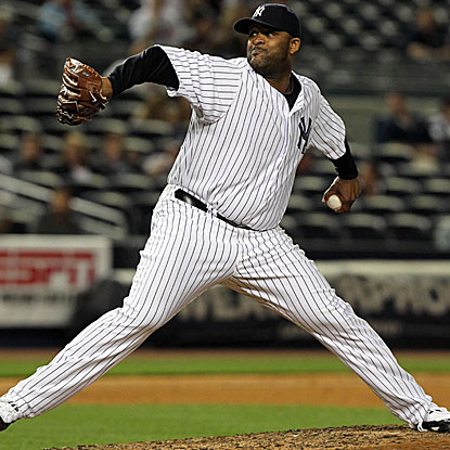 The Yankees' CC Sabathia strikes out 10 in a complete-game victory over the Braves. (US Presswire)