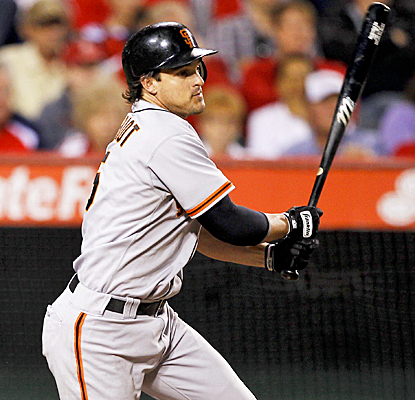Ryan Theriot helps out Matt Cain and the Giants by going 3 for 5 with two RBI against the Angels. (AP)