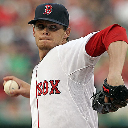 The Red Sox's Clay Buchholz allows five runs in six innings but hangs on to win his fourth straight. (Getty Images)