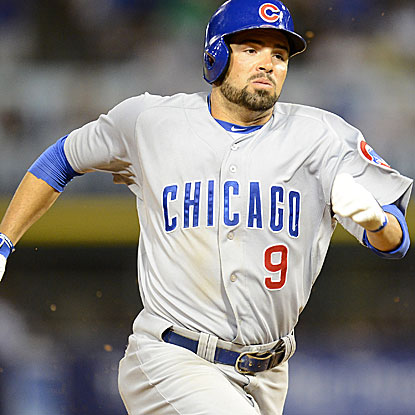 David DeJesus knocks in both the Cubs' runs with a single in the third inning and adds a triple in the 9th.  (US Presswire)