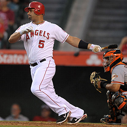 Albert Pujols connects for a three-run HR in the first inning and drives in four runs overall in the Angels' victory.  (Getty Images)