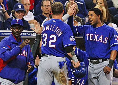 Manager Ron Washington and teammates alike are happy to see Josh Hamilton back in action and being productive. (AP)