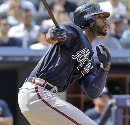 Jason Heyward watches his second home run, giving the Braves a 9-5 lead in the eighth inning vs. the Yankees.  (AP)