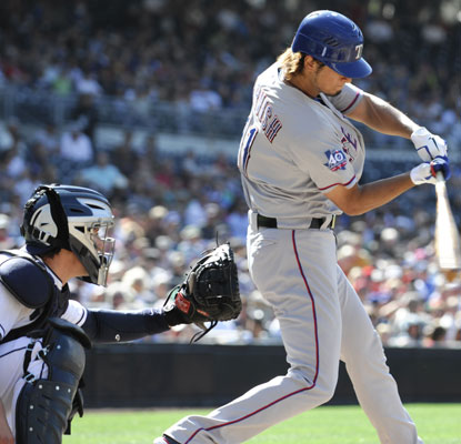 Yu Darvish gets his ninth win and first major-league hit while the Rangers add to their winning streak.  (Getty Images)