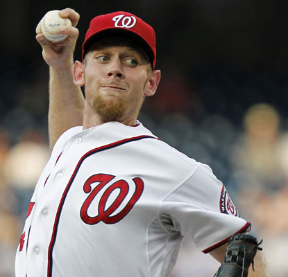 Stephen Strasburg (9-1) wins his sixth consecutive start, throwig 111 pitches and holding the Rays to two runs.  (AP)