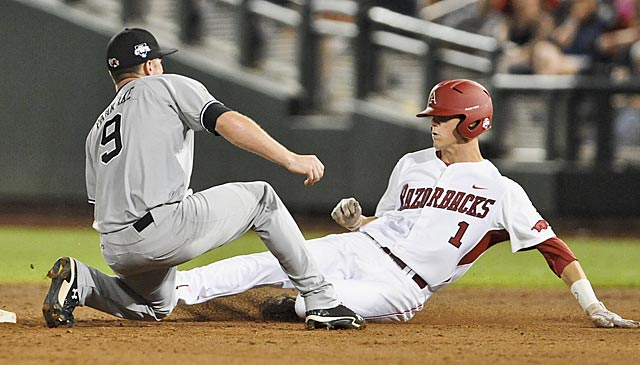 South Carolina's Joey Pankake tags out Arkansas' Brian Anderson during a double play in the eighth inning. (AP)