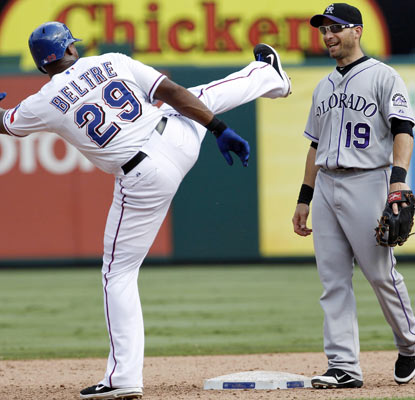 Adrian Beltre gives a playful kick to Marco Scutaro, but it's the Rockies who cut down the red-hot Rangers.  (US Presswire)