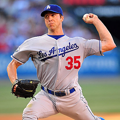 The Dodgers' Chris Capuano holds the Angels to one run on seven hits in seven innings of work to earn the victory.  (US Presswire)