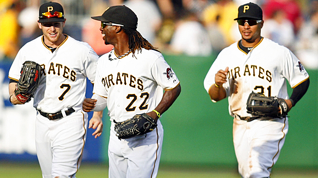 Andrew McCutchen (center) has single-handedly carried the Pirates at the plate. (US Presswire)