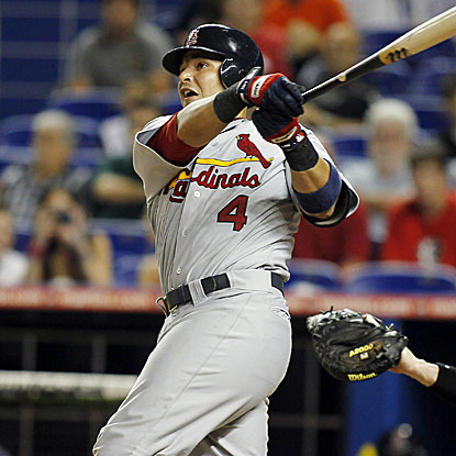 Yadier Molina's two-run homer in the ninth inning caps a four-run rally to tie the game for the Cardinals. (AP)