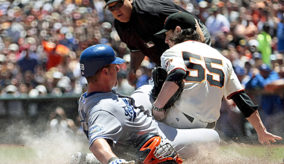 Tim Lincecum applies the tag as Chad Billingsley slides toward home plate. (US Presswire)