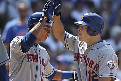 Scott Hairston (right) -- who hits a grand slam --  is one of four Mets players with at least four RBI in the rout. (Getty Images)