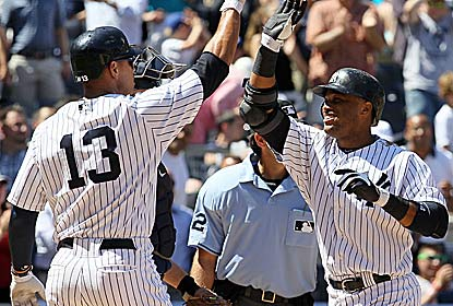 Robinson Cano (right) hits the go-ahead HR to save the day for the Yankees, who lose Andy Pettitte to an ankle injury. (Getty Images)